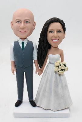 Custom wedding cake topper in wedding gown and suits