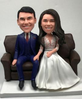 Custom cake topper sitting on sofa