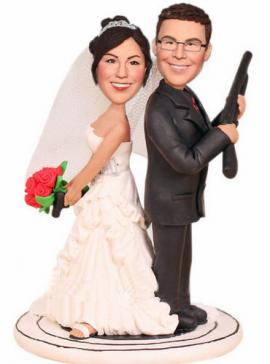 Custom wedding cake topper with guns