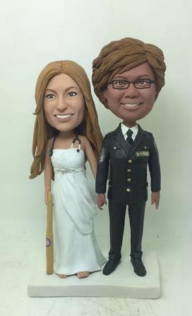 Lesbian doctor and policawoman cake toppers