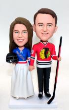 Custom Hockey wedding cake topper in Blackhawks and Ranger jerses