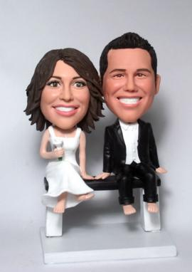 Couple sitting on bench Cake Toppers