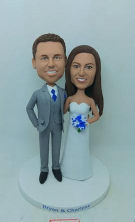 Wedding cake topper with grey suit and blue flowers