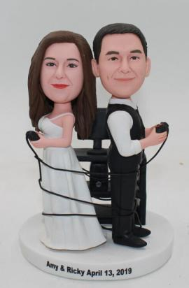 Custom cake topper playing Xbox game