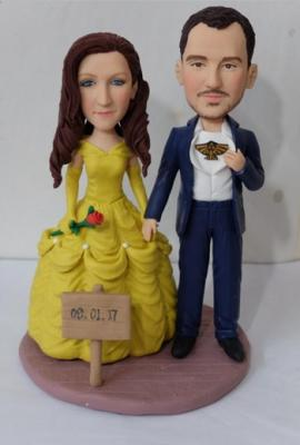Wedding cake topper with bride like Belle in beauty and the beast