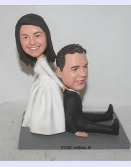 Bride dragging groom Wedding Cake Toppers