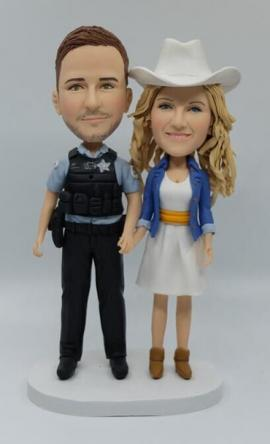 Custom wedding cake topper with policeman groom