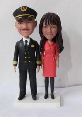 Pilot groom and Flight Attendant bride wedding cake topper