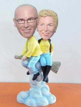 Couple on the broomstick cake toppers