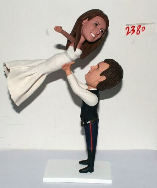 Custom Hans Solo lifting bride like Dirty Dancing cake topper