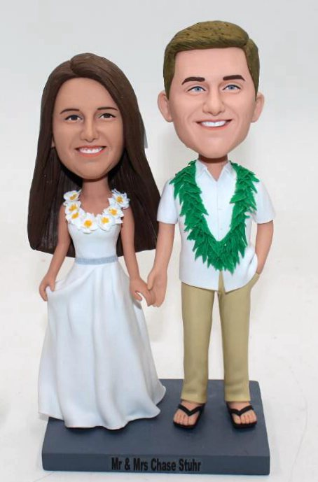 Custom Hawaii style wedding cake topper with leis