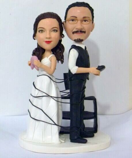 Custom Wrapped up in Xbox games wedding cake topper