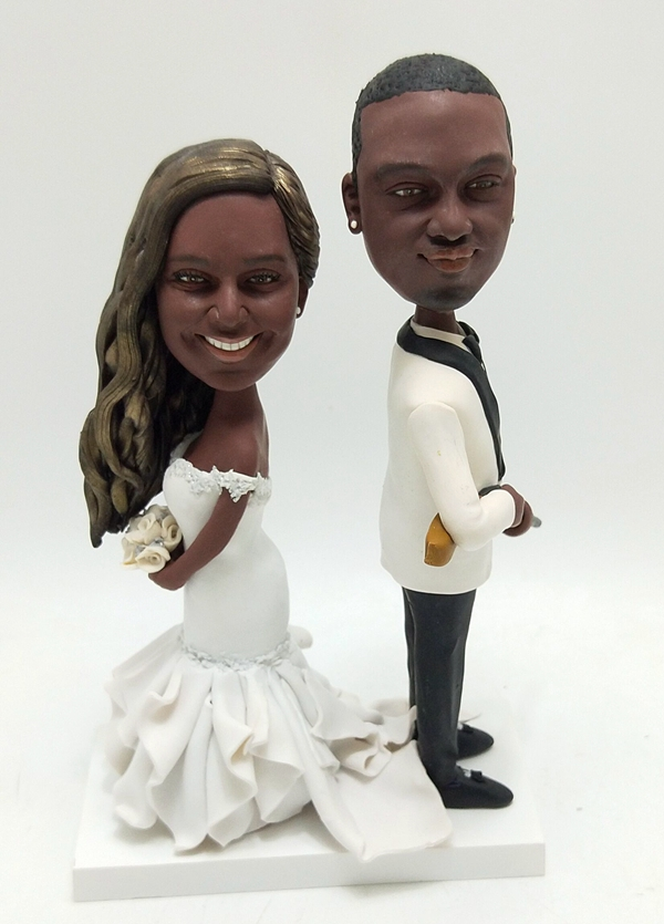 Custom Custom African American wedding cake topper with gun