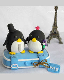 Travelling Penguins wedding cake toppers