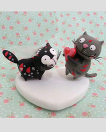 Wedding cake toppers playing cats