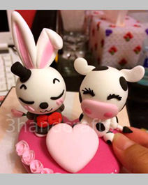 Wedding cake toppers rabbit and cattle