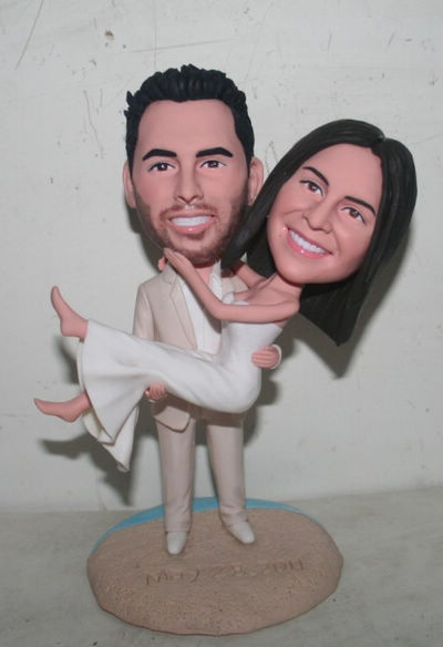 Custom Groom holding bride wedding cake topper
