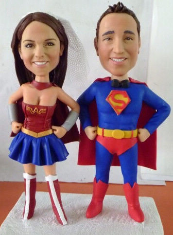 Custom Superman and wonderwoman cake topper