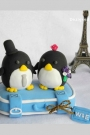 Custom Travelling Penguins wedding cake toppers